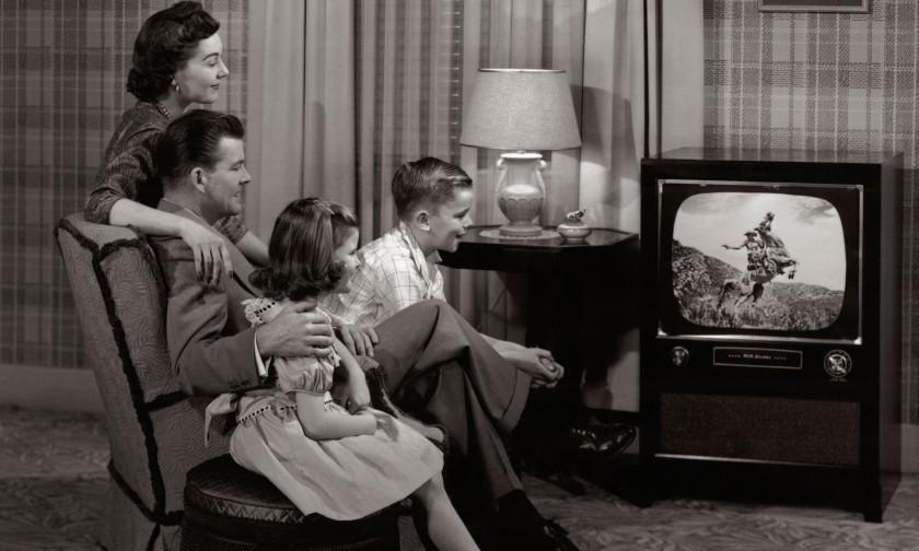 Family watching TV 1960's