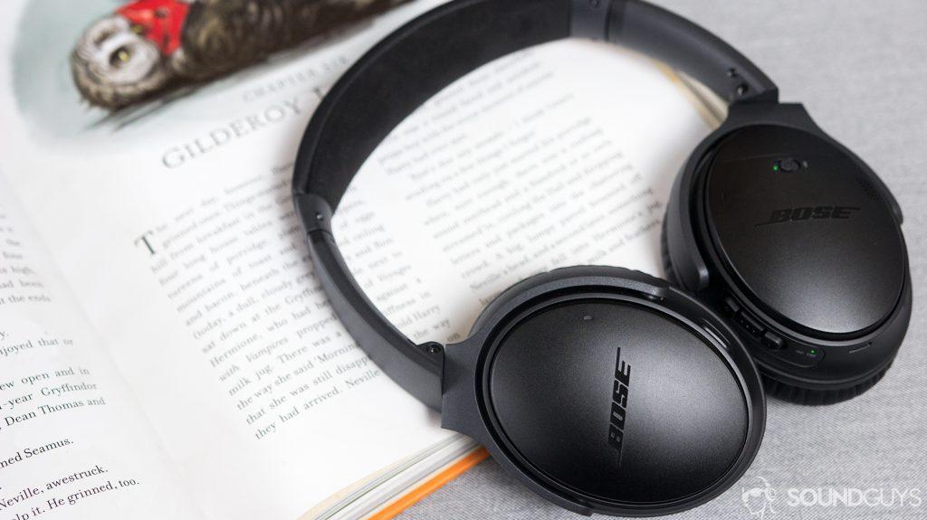 Bose QuietComfort 35 II headphones resting against an open notebook.