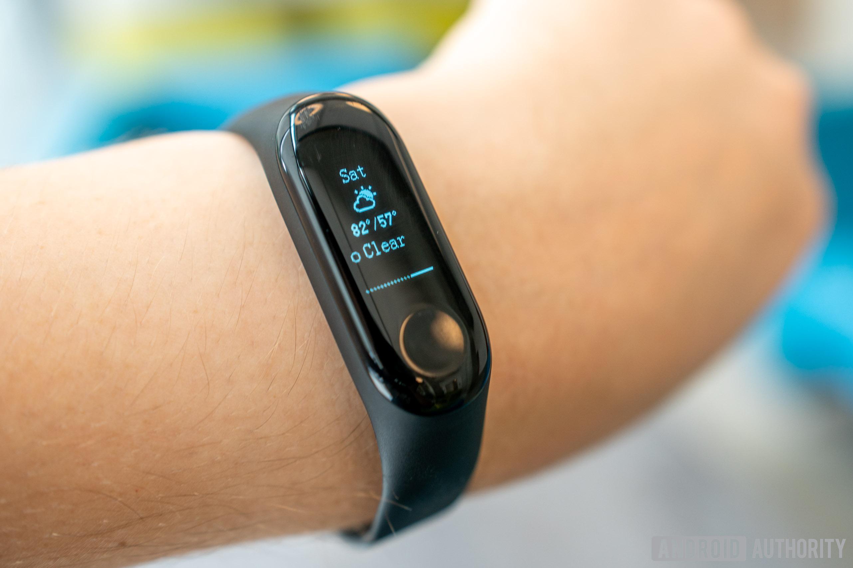 The Xiaomi Mi Band 3 on a person's wrist.