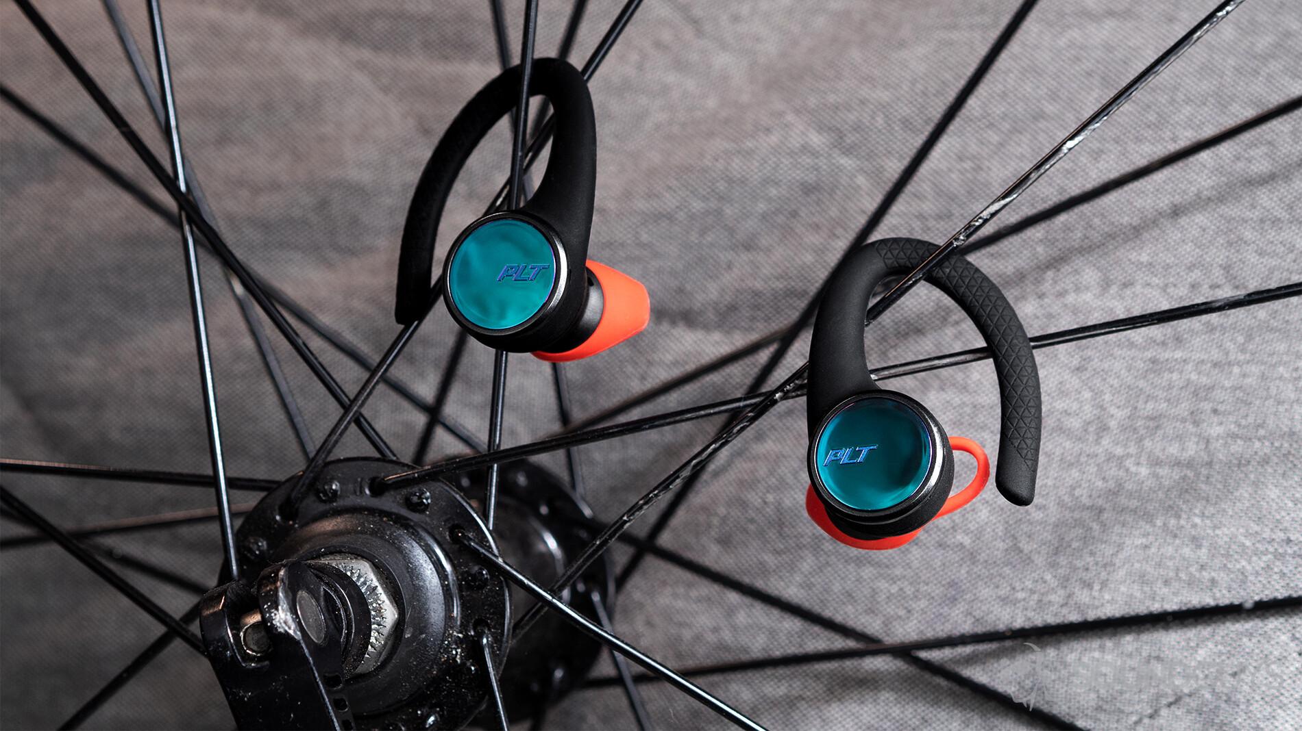 Plantronics BackBeat Fit 3100 earbuds on bike spokes.