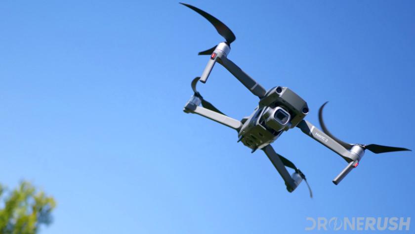 DJI Mavic 2 Pro flying blue sky with a tree dr