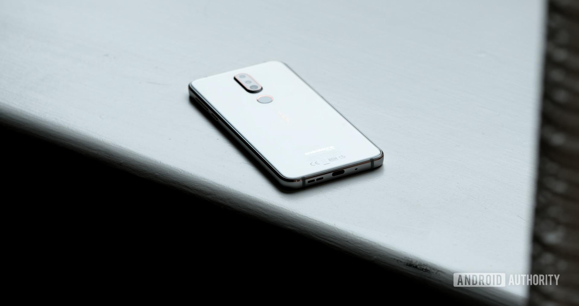 Nokia 7.1 back glass on window