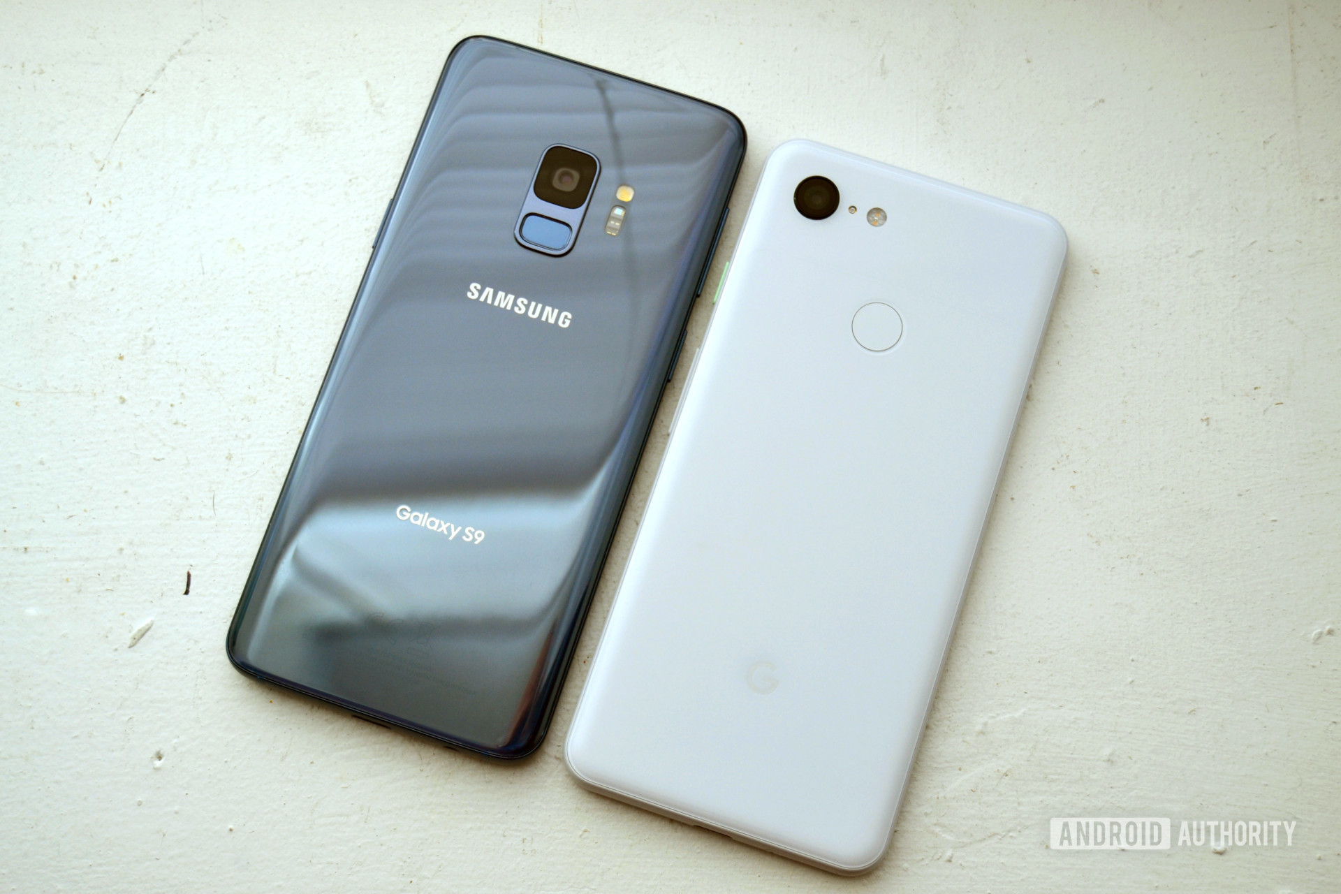 Photo of the backside of a google pixel 3  next to a samsung galaxy s9 comparing cameras design
