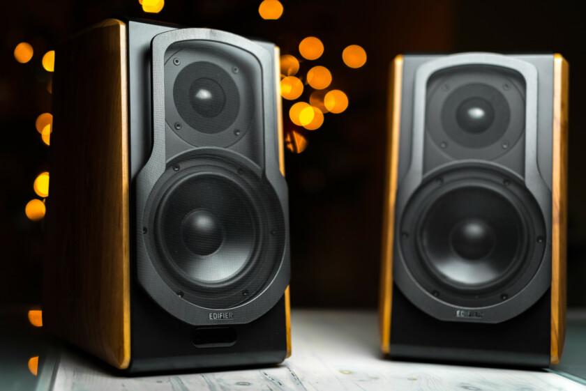 Hero image of the Edifier S1000A smart bookshelf speakers with Alexa. Orange bokeh in the background.