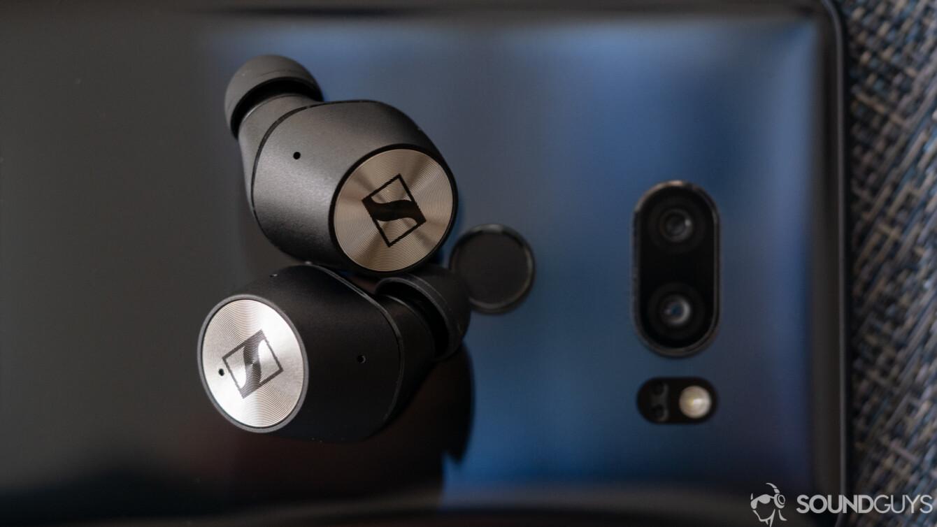 Sennheiser Momentum True wireless earbuds on a phone.