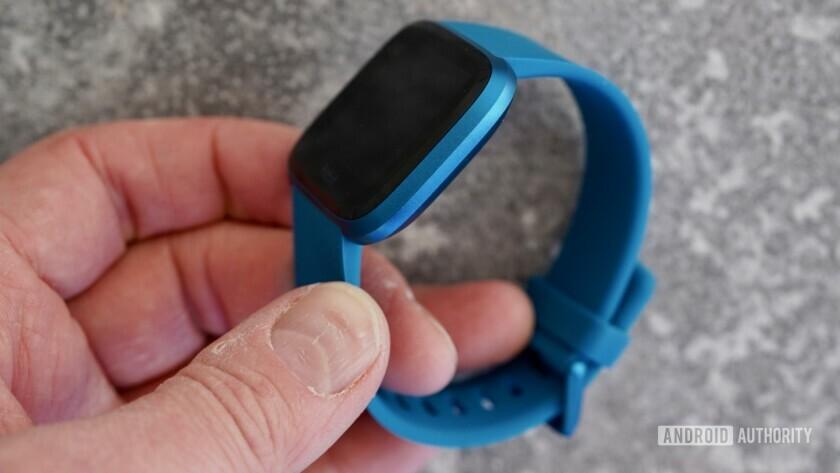 Fitbit Versa Lite in hand size comparison