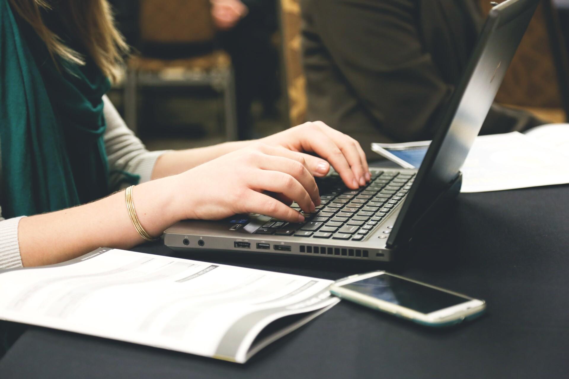 woman-typing-writing-coding-laptop