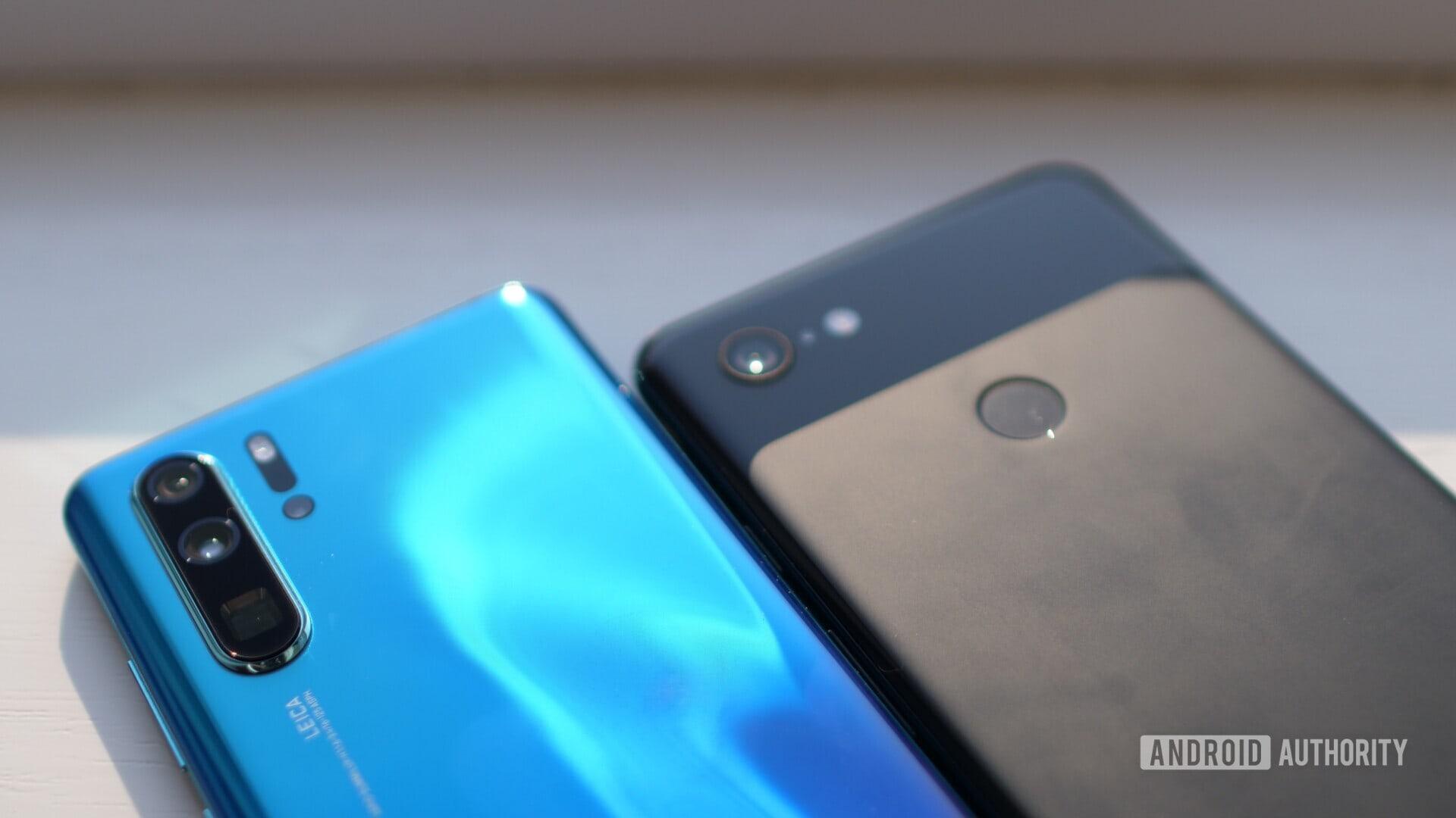 rear of blue huawei p30 pro vs black google pixel 3 xl