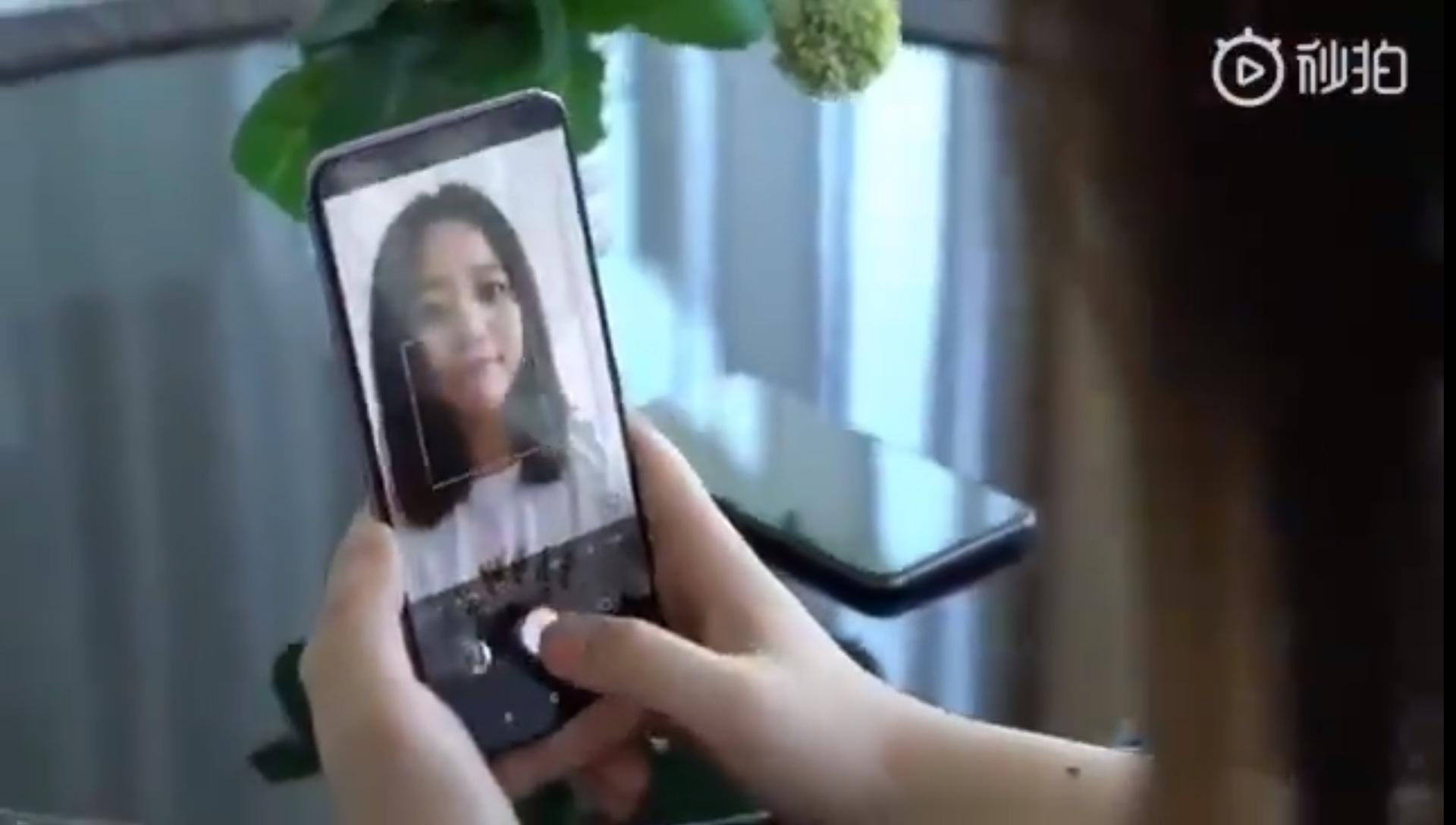 Xiaomi Mi 9 with under screen camera taking a selfie.