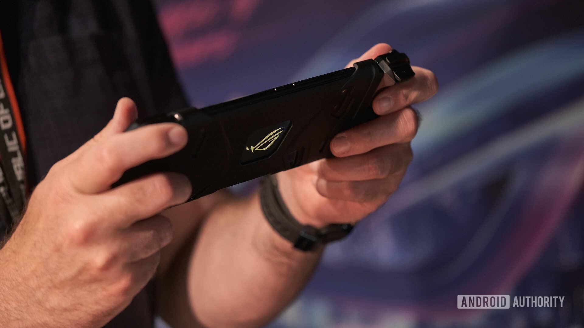 Asus ROG Phone 2 gaming on Kunai gamepad adapter from behind
