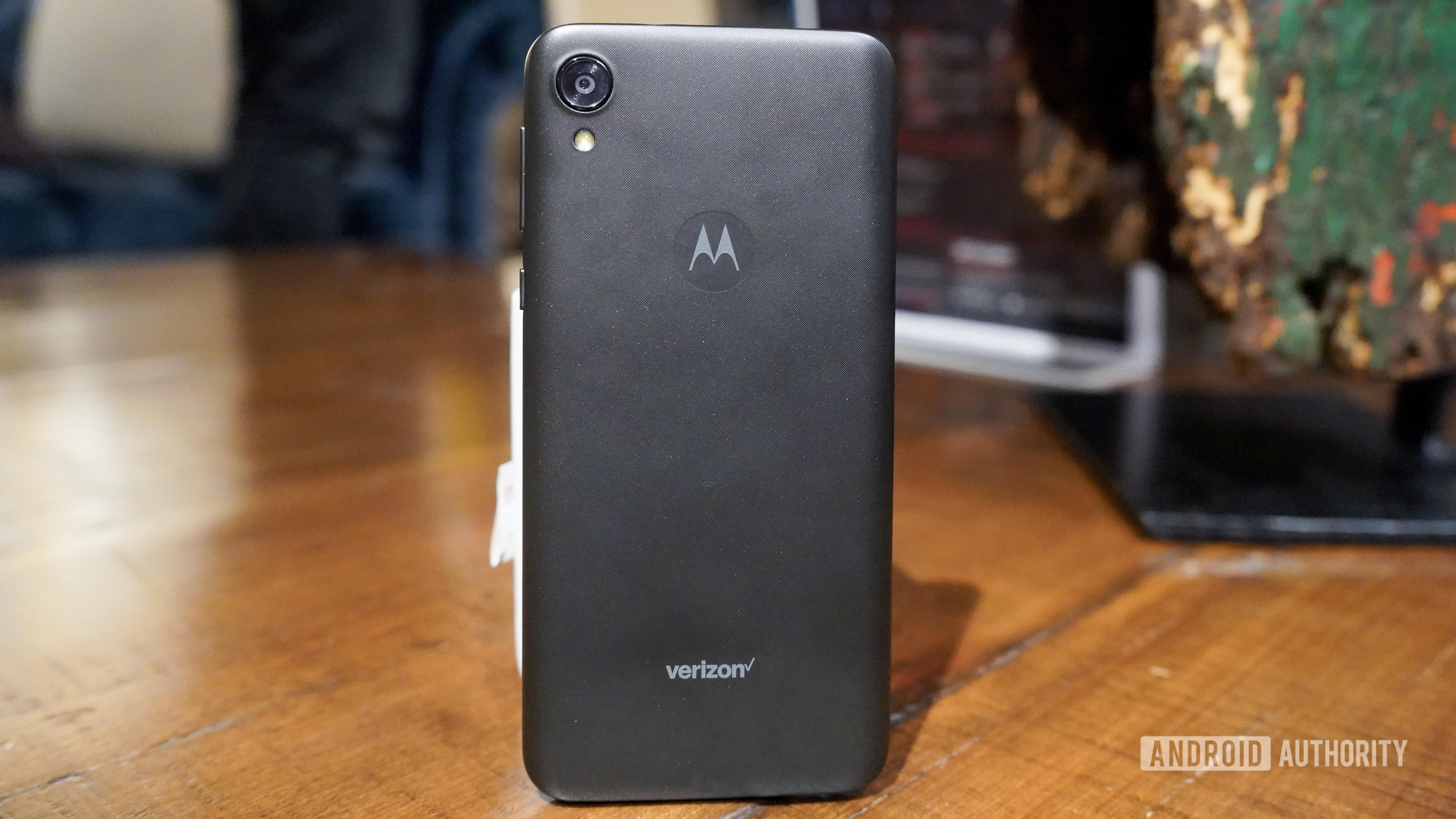 Motorola Moto E6 hands on leaning on mug