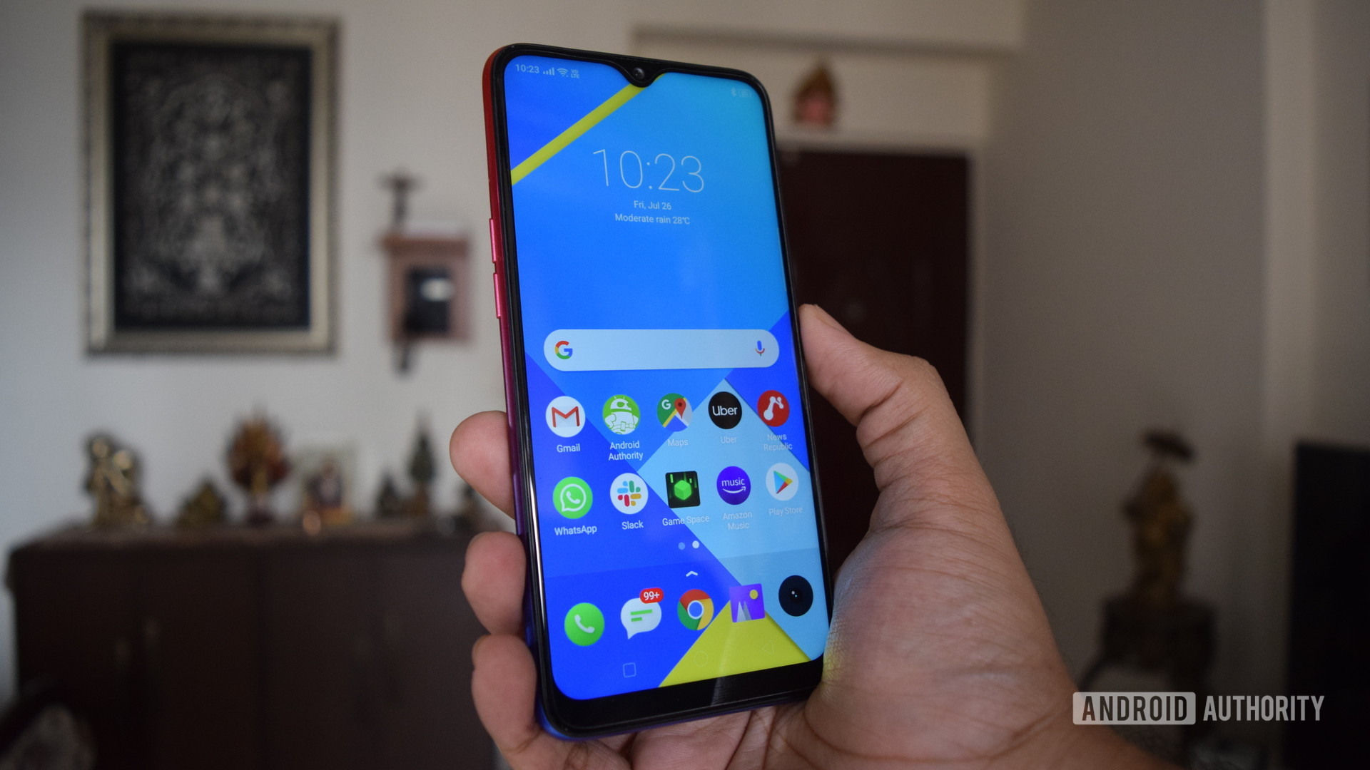 realme 3i review phone in hand showing display