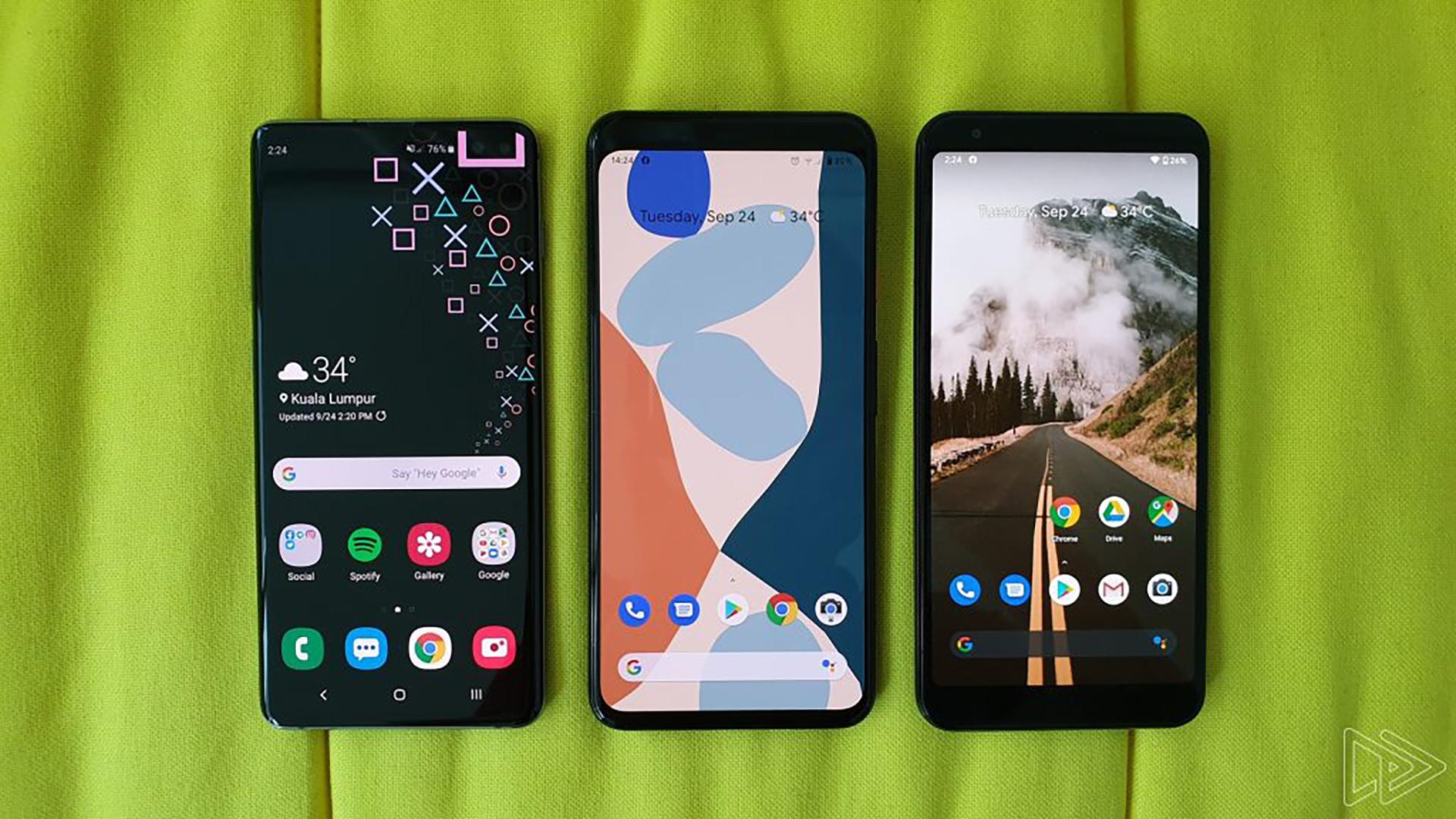 Google Pixel 4 XL between a Samsung Galaxy S10 Plus and a Google Pixel 3a XL