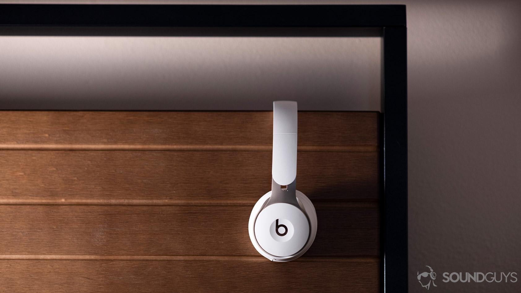 Beats Solo Pro noise cancelling headphones profile wood background