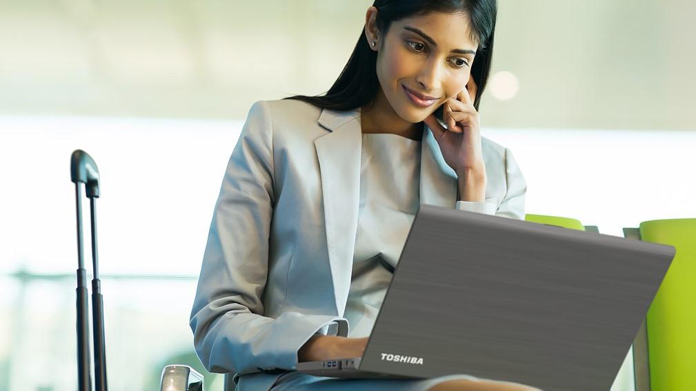 Woman using Toshiba laptop