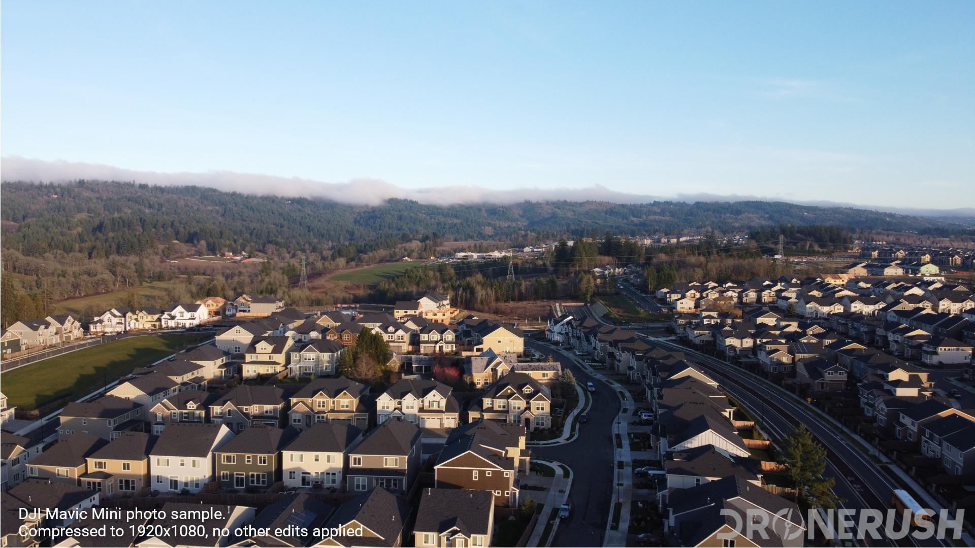 DJI Mavic Mini photo sample buildings and hills sun behind