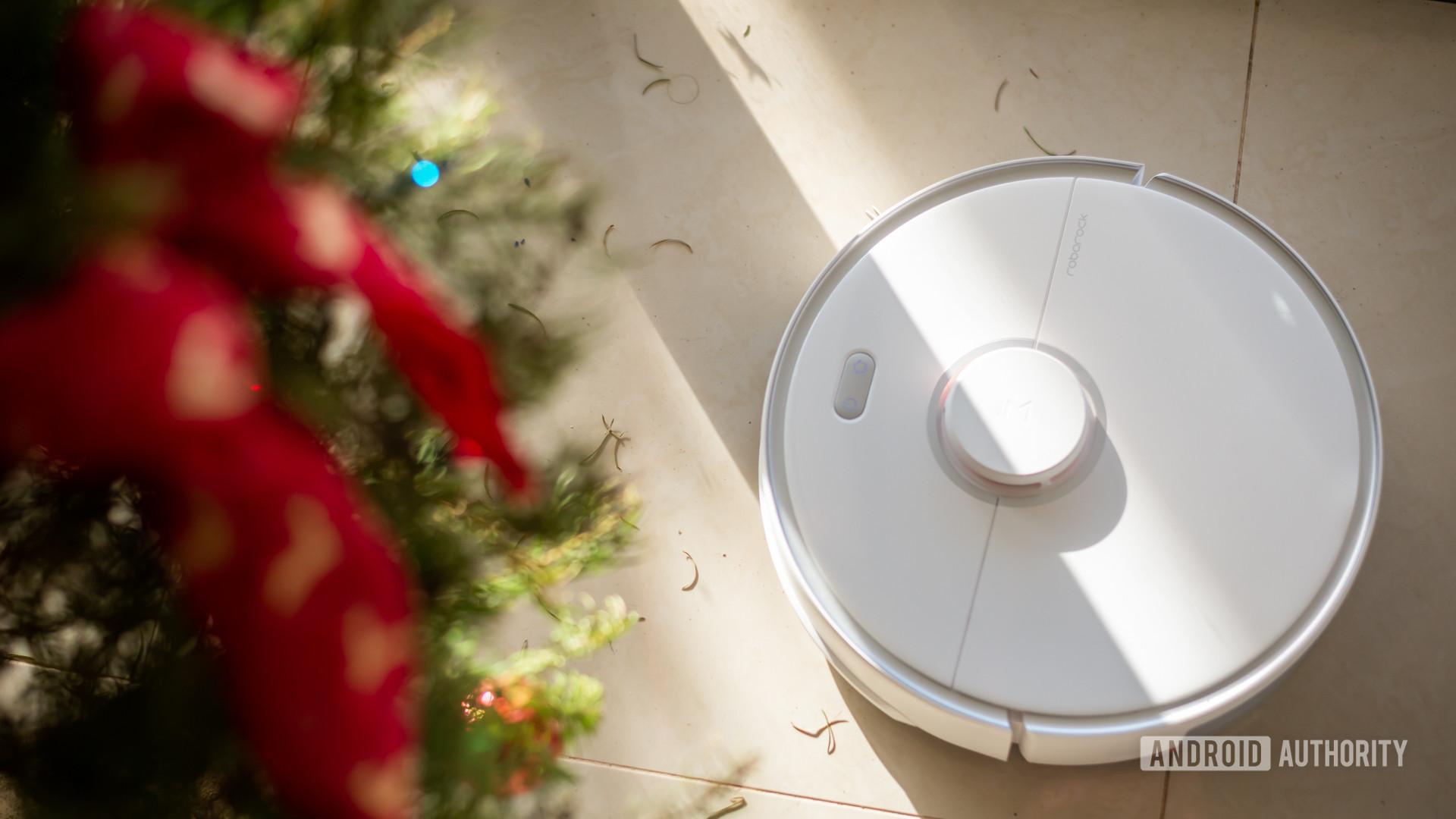 Roborock S5 Max robot vacuum sweeping under christmas tree 4