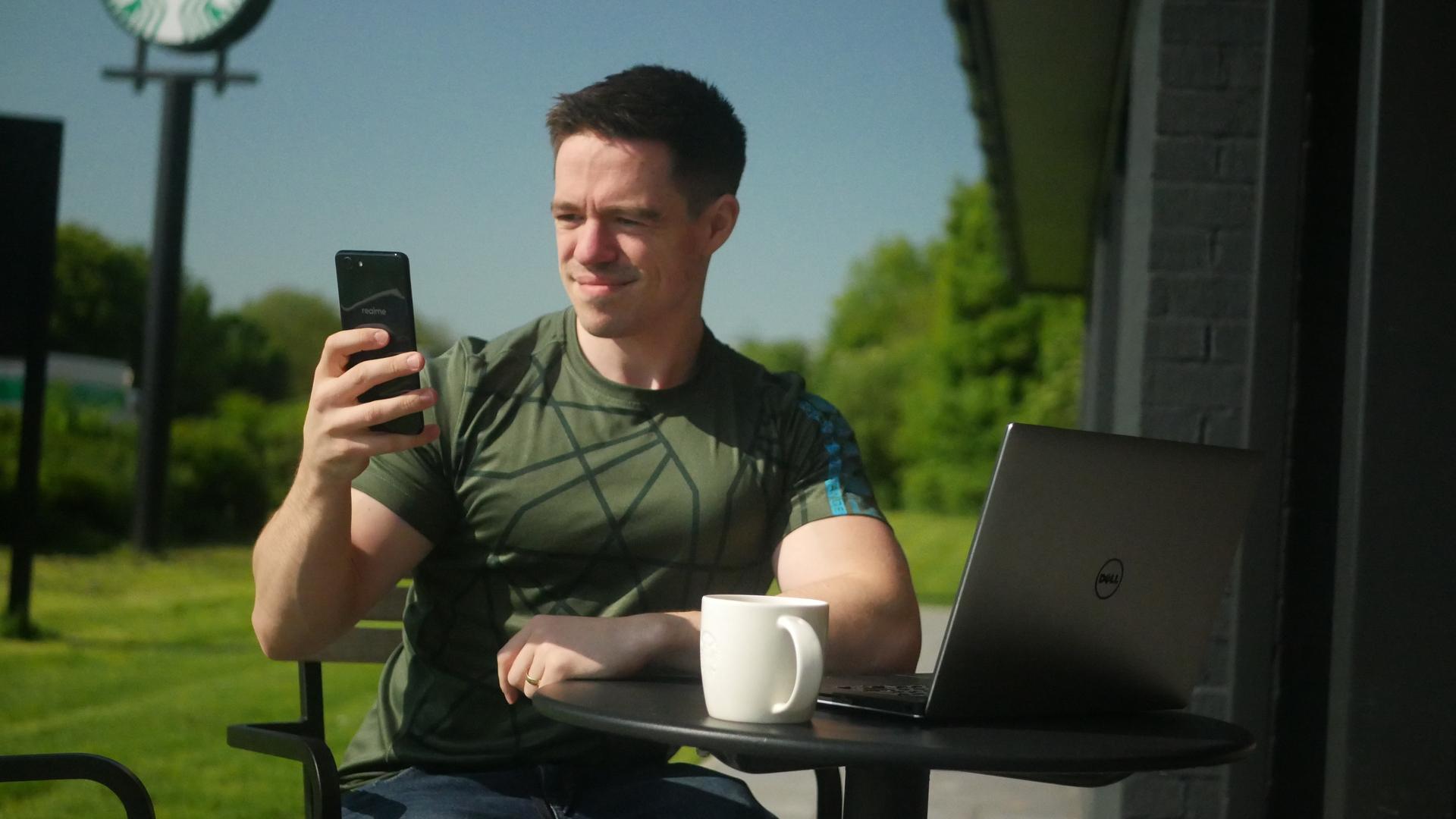 Adam Using Phone