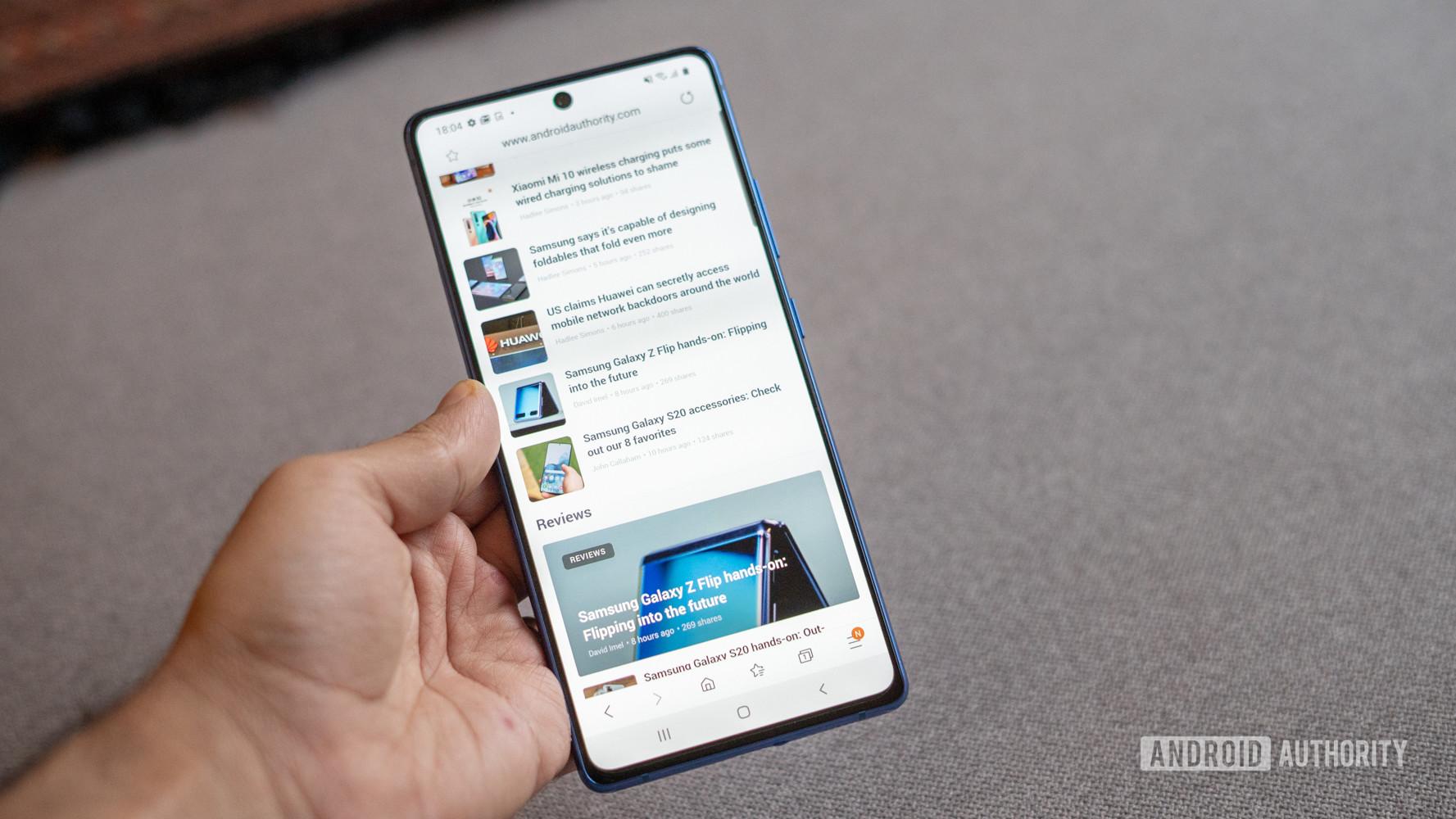 Samsung Galaxy S10 Lite in hand showing browser