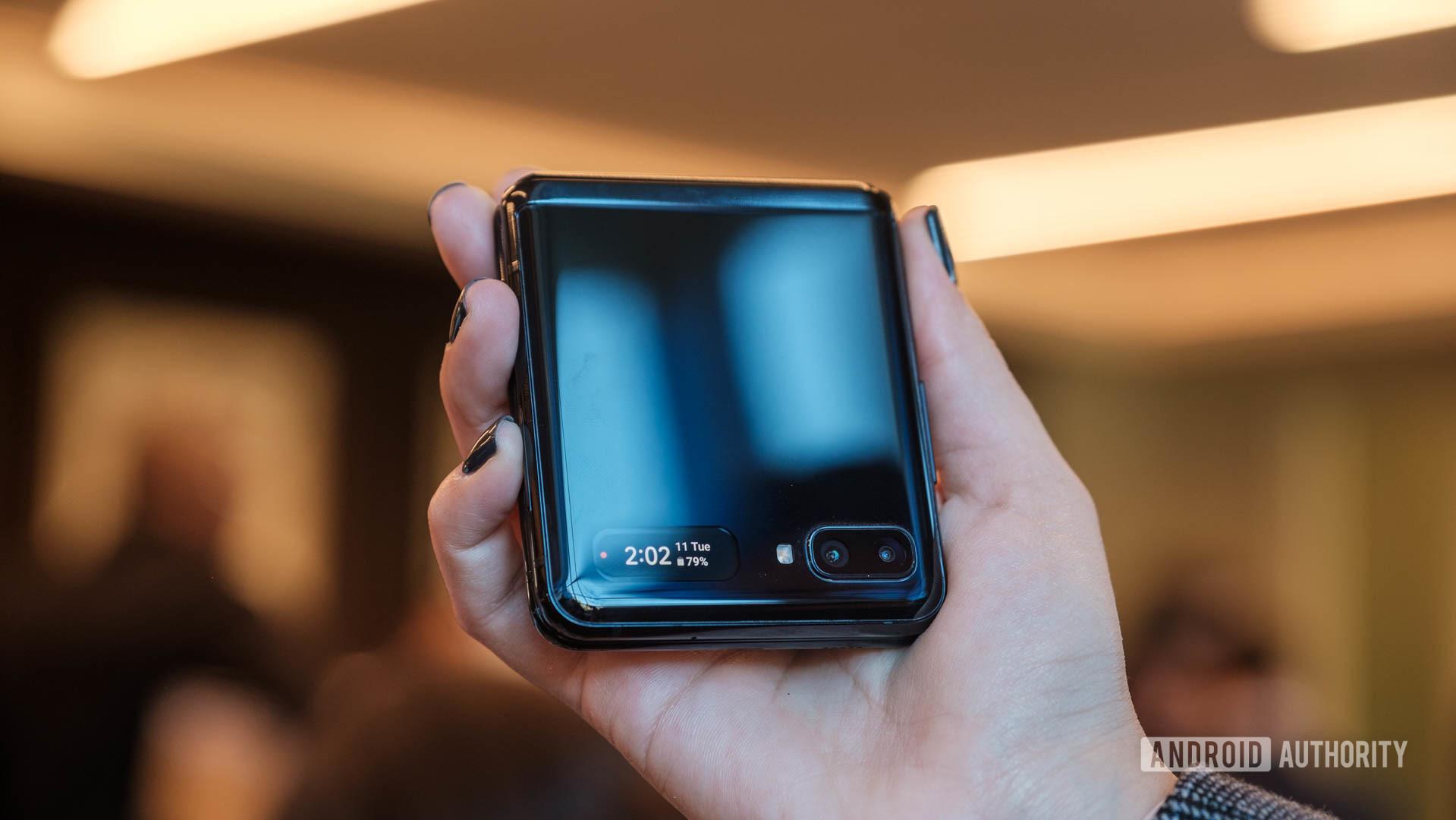 Samsung Galaxy Z Flip hands on half folded in hand 2