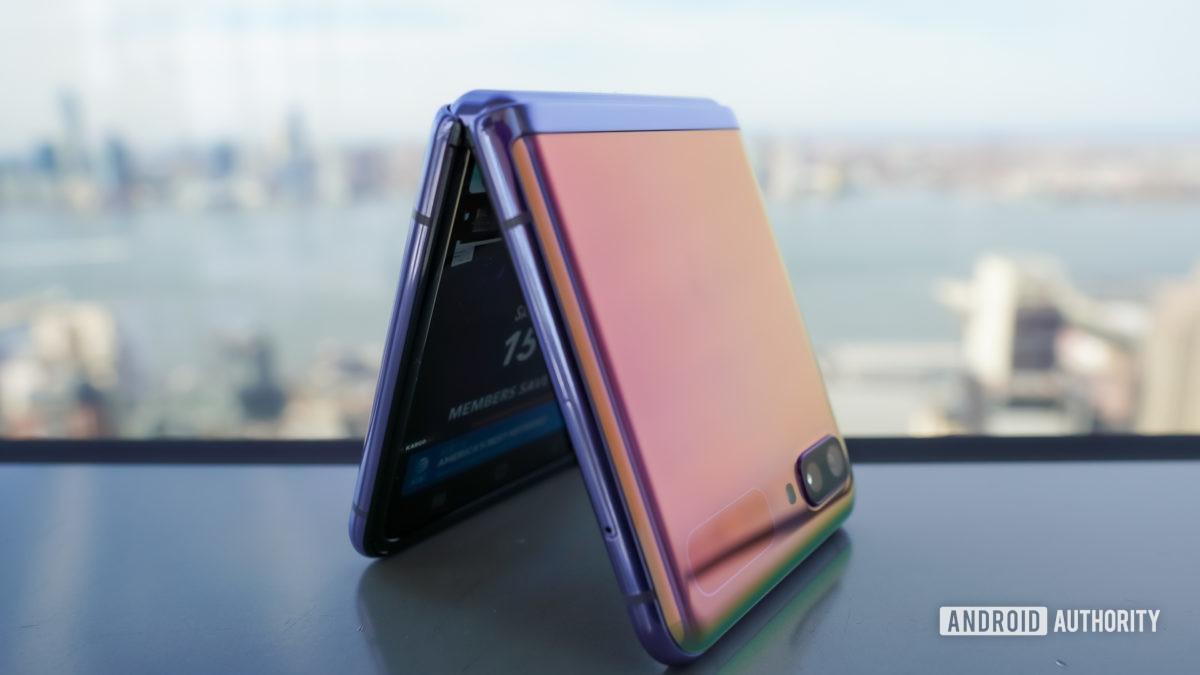 Samsung Galaxy Z Flip standing with city