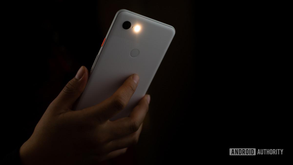 Smartphone flashlight on stock photo 2 - Photography tips