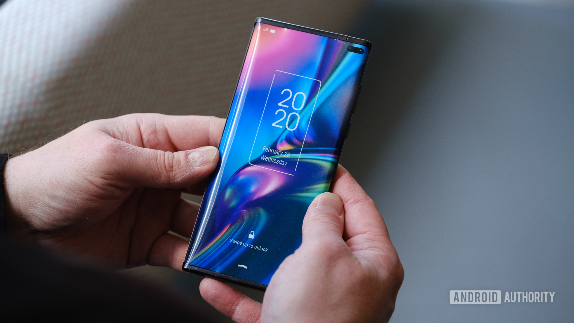 TCL rollable concept phone closed in hand