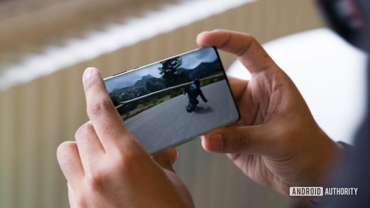 Motorola Edge watching video in hand 1