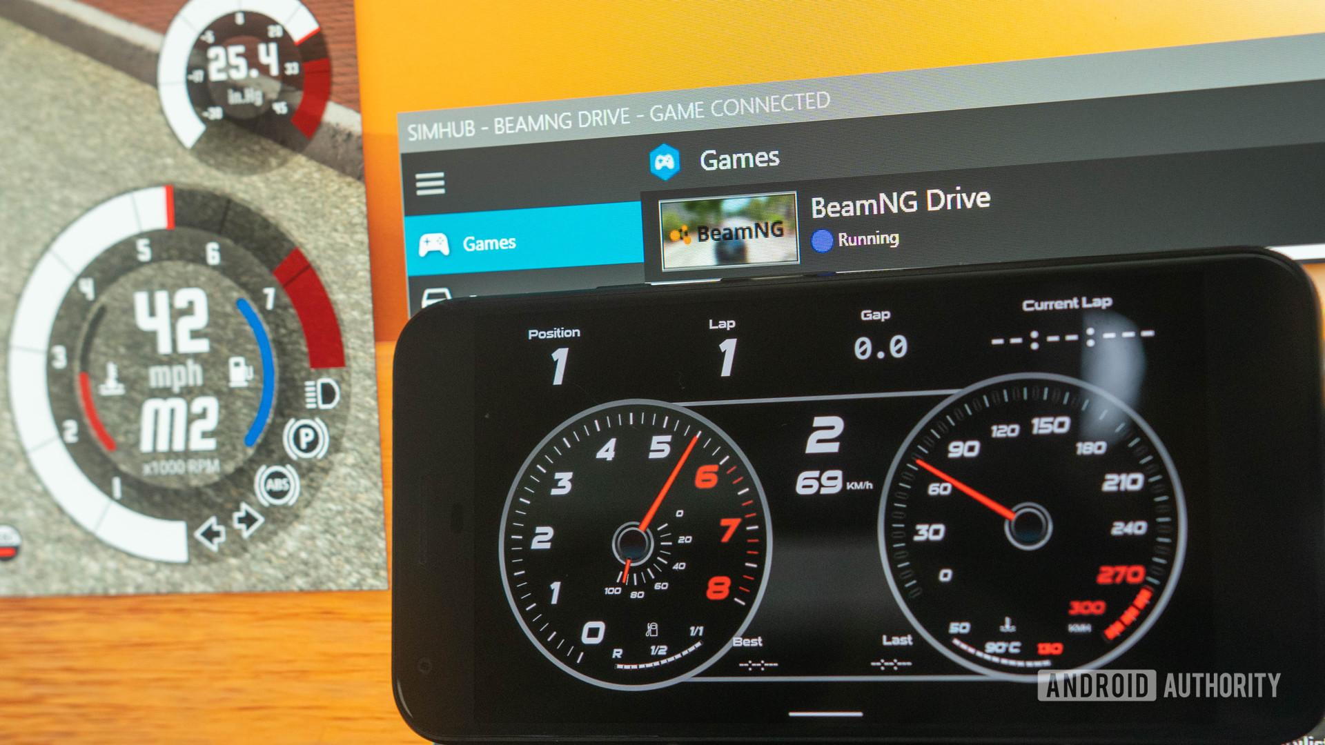 SimHub app next to Windows PC sim racing dashboard