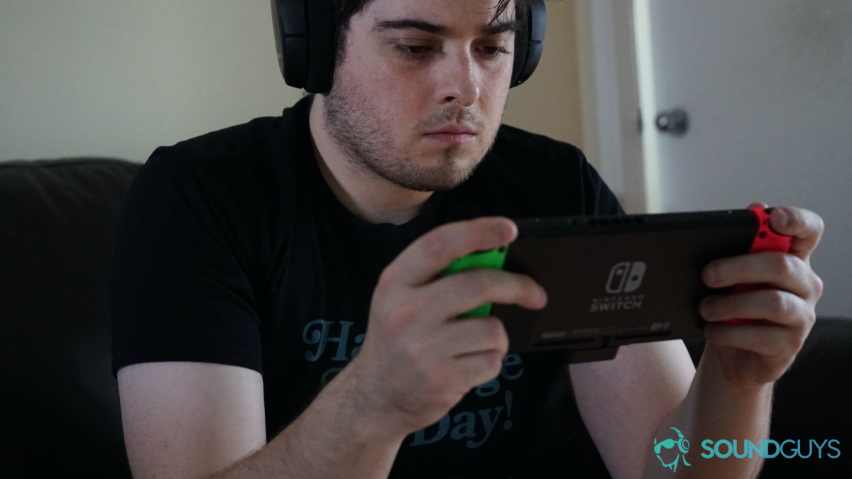 A picture of the SteelSeries Arctis 1 Wireless being used by a man playing on a Nintendo Switch.