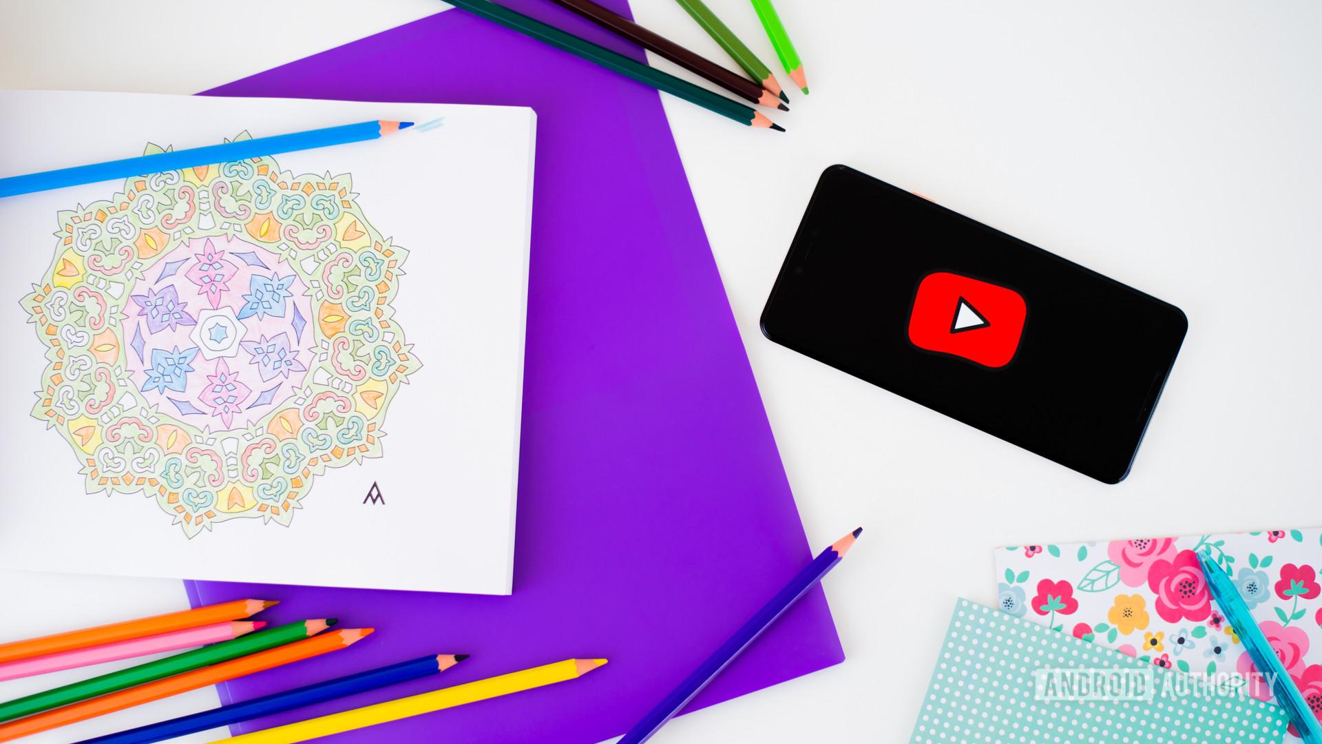 YouTube Kids logo on smartphone stock photo 1