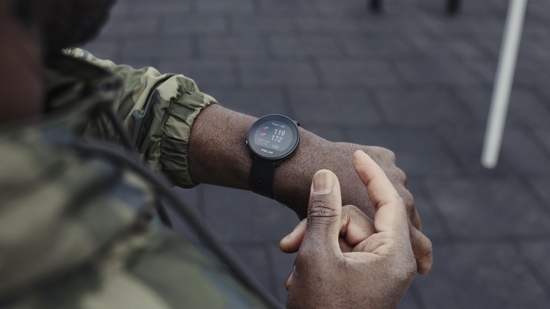 polar unite fitness watch on wrist