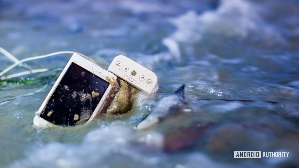E Discarded smartphone on the beach 2