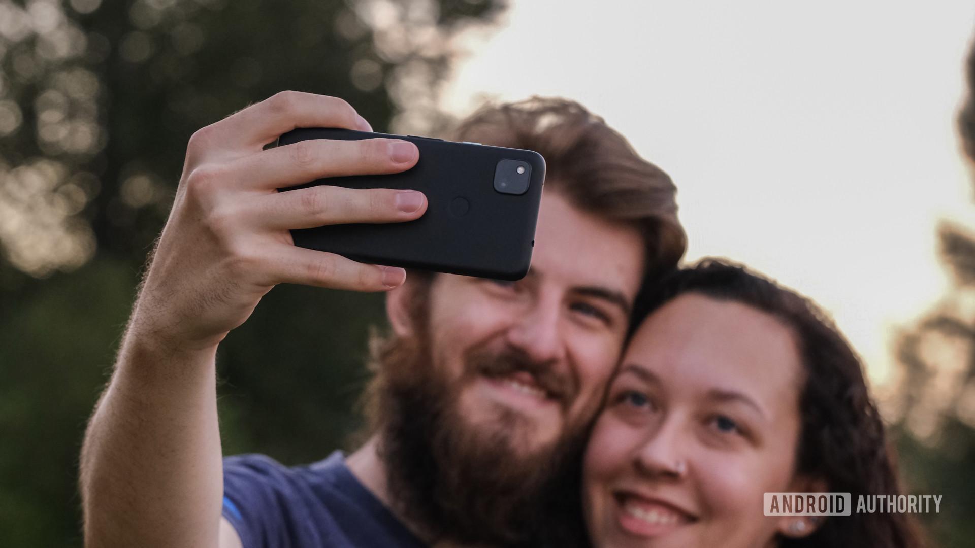 Google Pixel 4a taking a selfie back wide