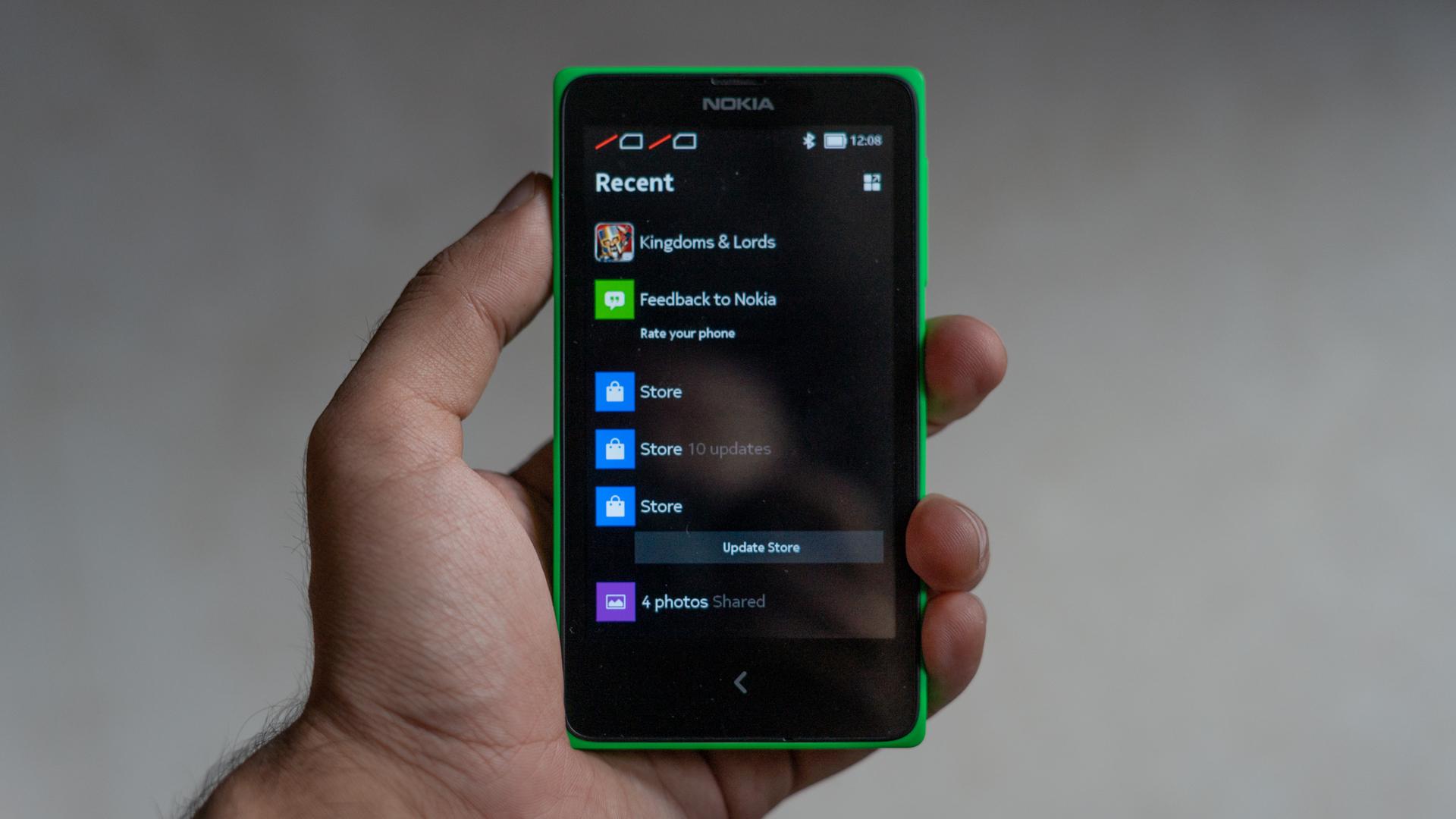 Nokia X Nokia XL in hand showing size