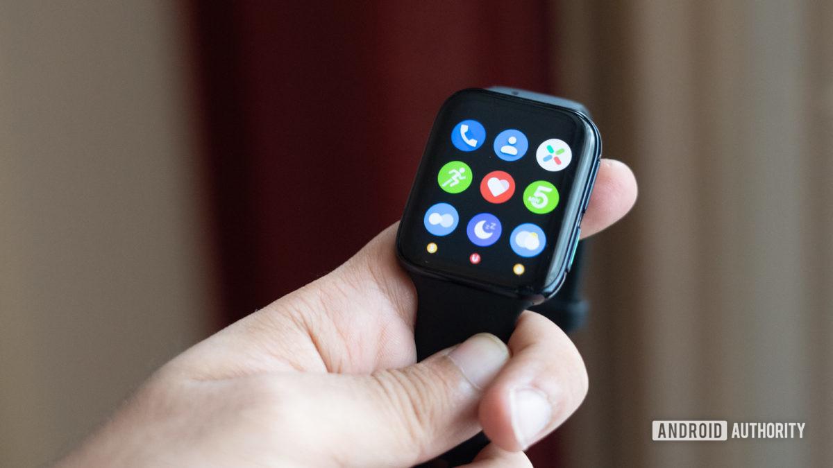 Oppo Watch in hand showing apps wear os smartwatch
