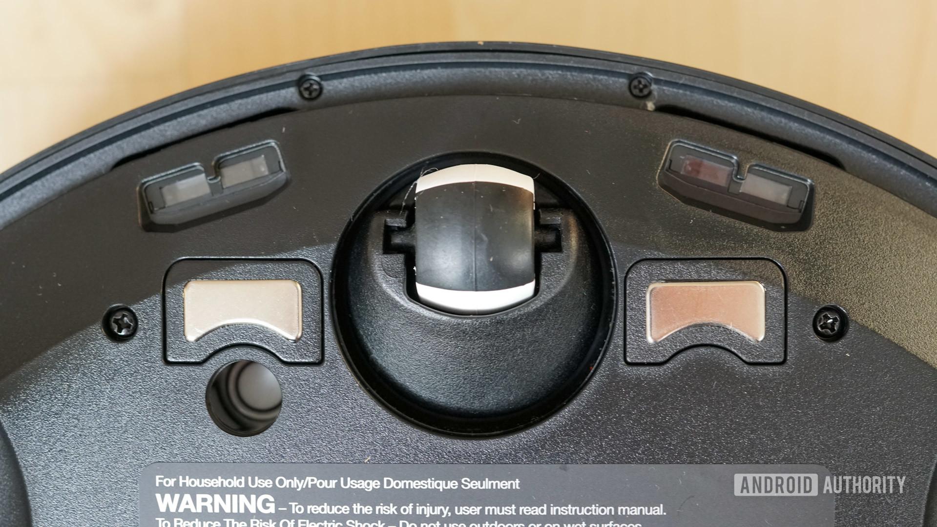 Ecovacs Deebot Ozmo T8 robot vacuum charging pads drop sensors and front wheel closeup
