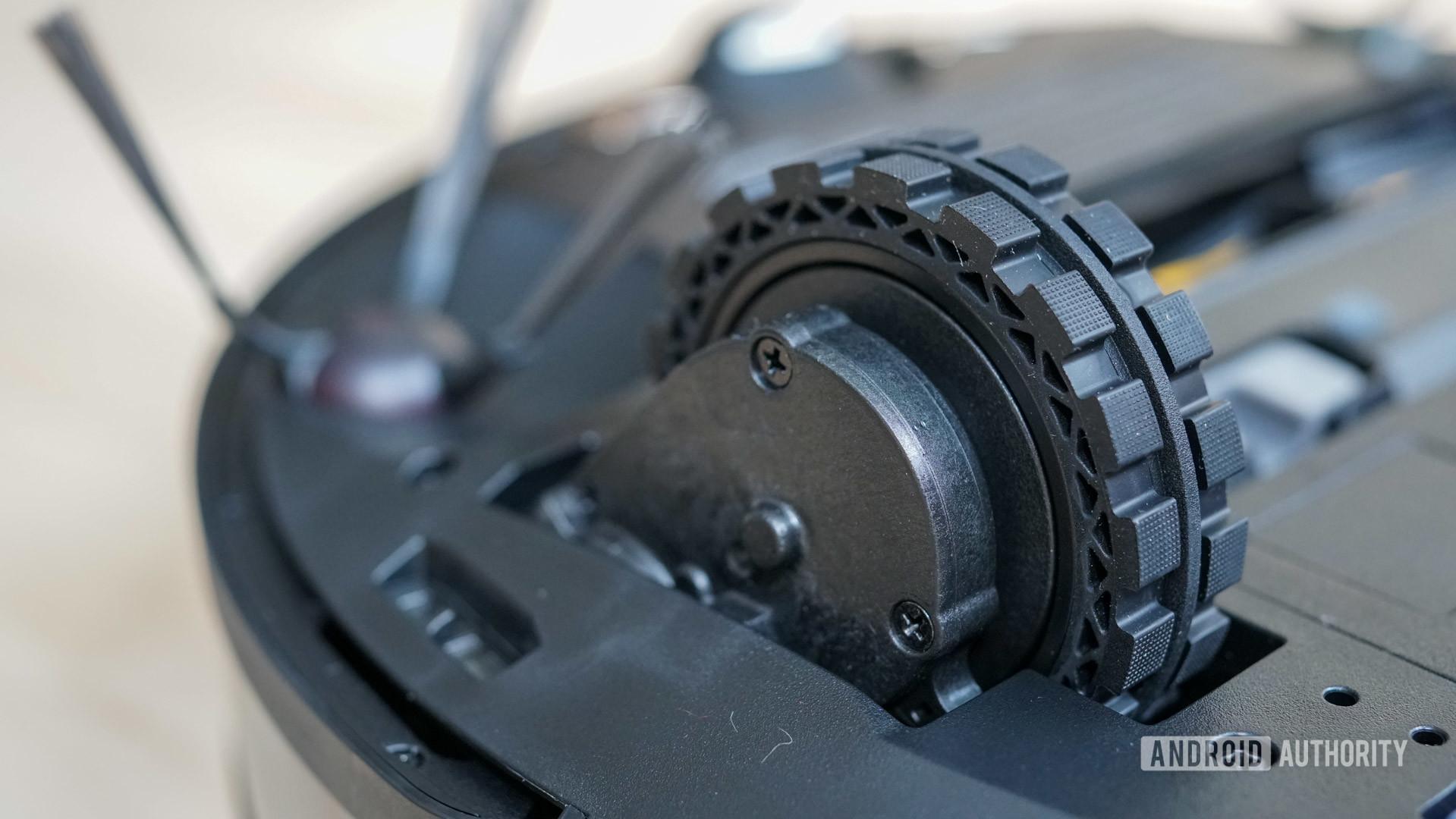 Ecovacs Deebot Ozmo T8 robot vacuum closeup of robot vacuum wheel