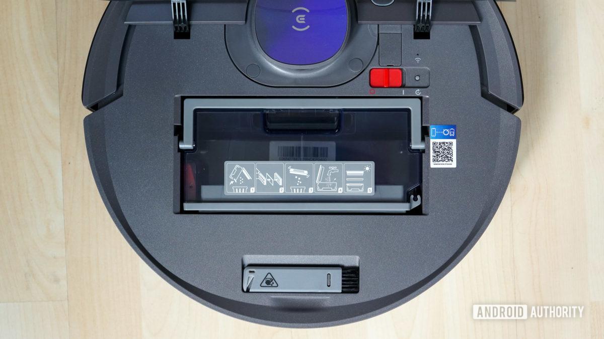 Ecovacs Deebot Ozmo T8 robot vacuum top down view under flap showing dustbin