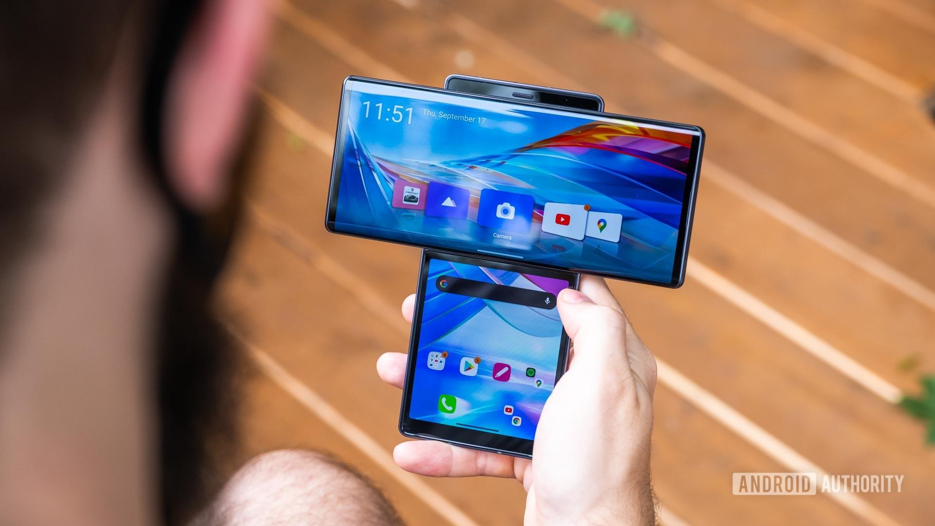 LG Wing swiveled home screens in hand