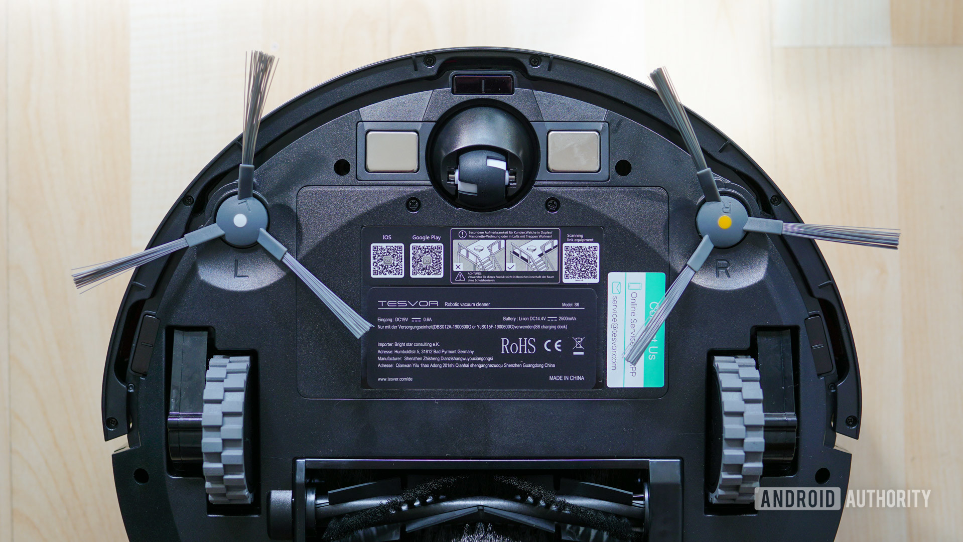 Tesvor S6 robot vacuum bottom view closeup wheels and brushes