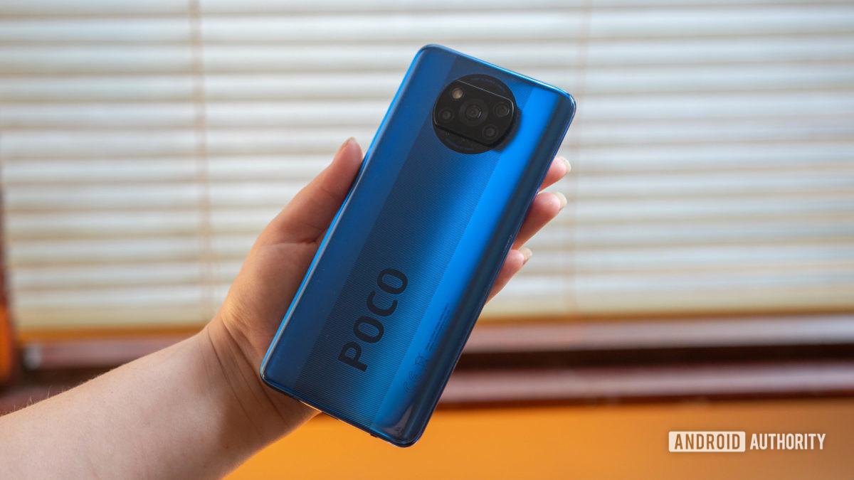 Xiaomi Poco X3 NFC held in the hand indoors