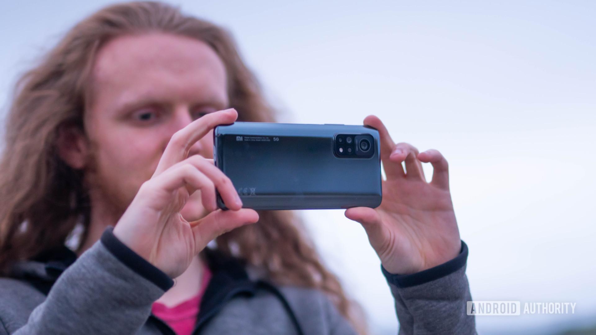 Xiaomi Mi 10T Pro holding the phone to take a photo