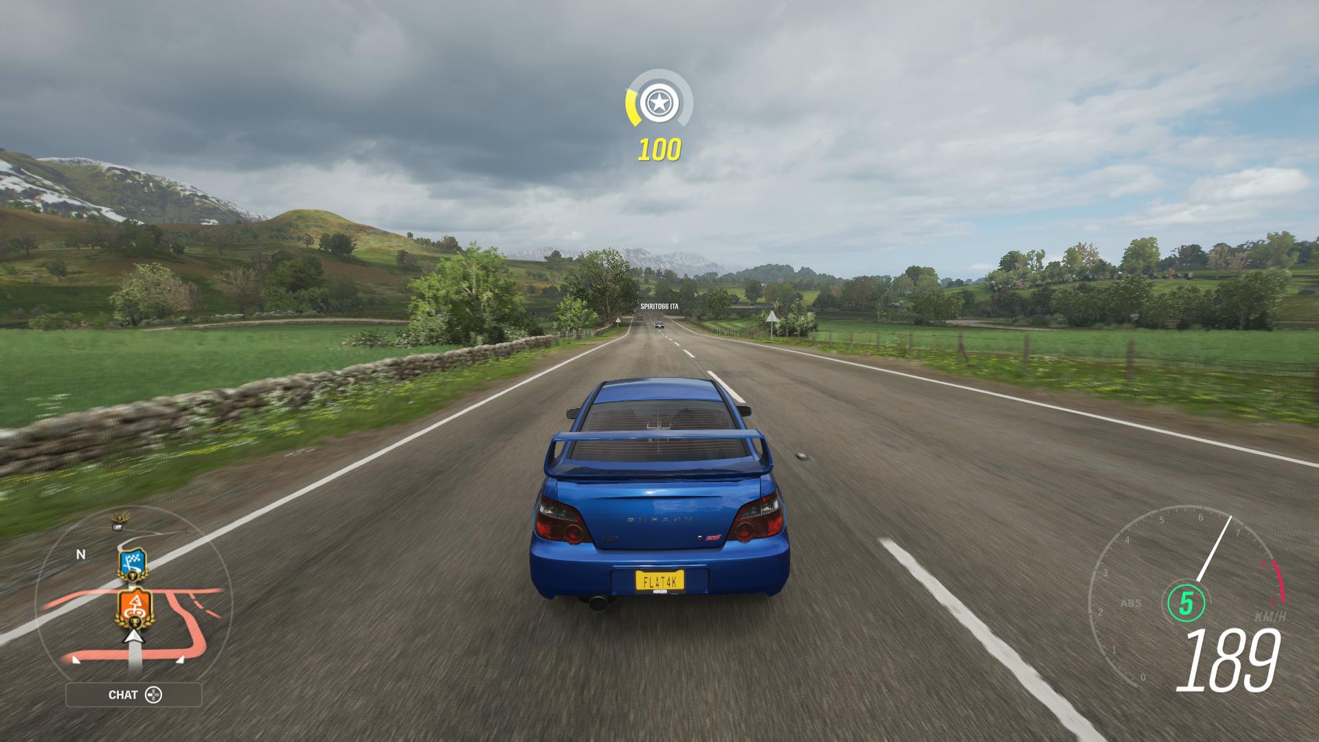 Xbox Series S screenshot of Forza Horizon 4 with a Subaru driving through the countryside
