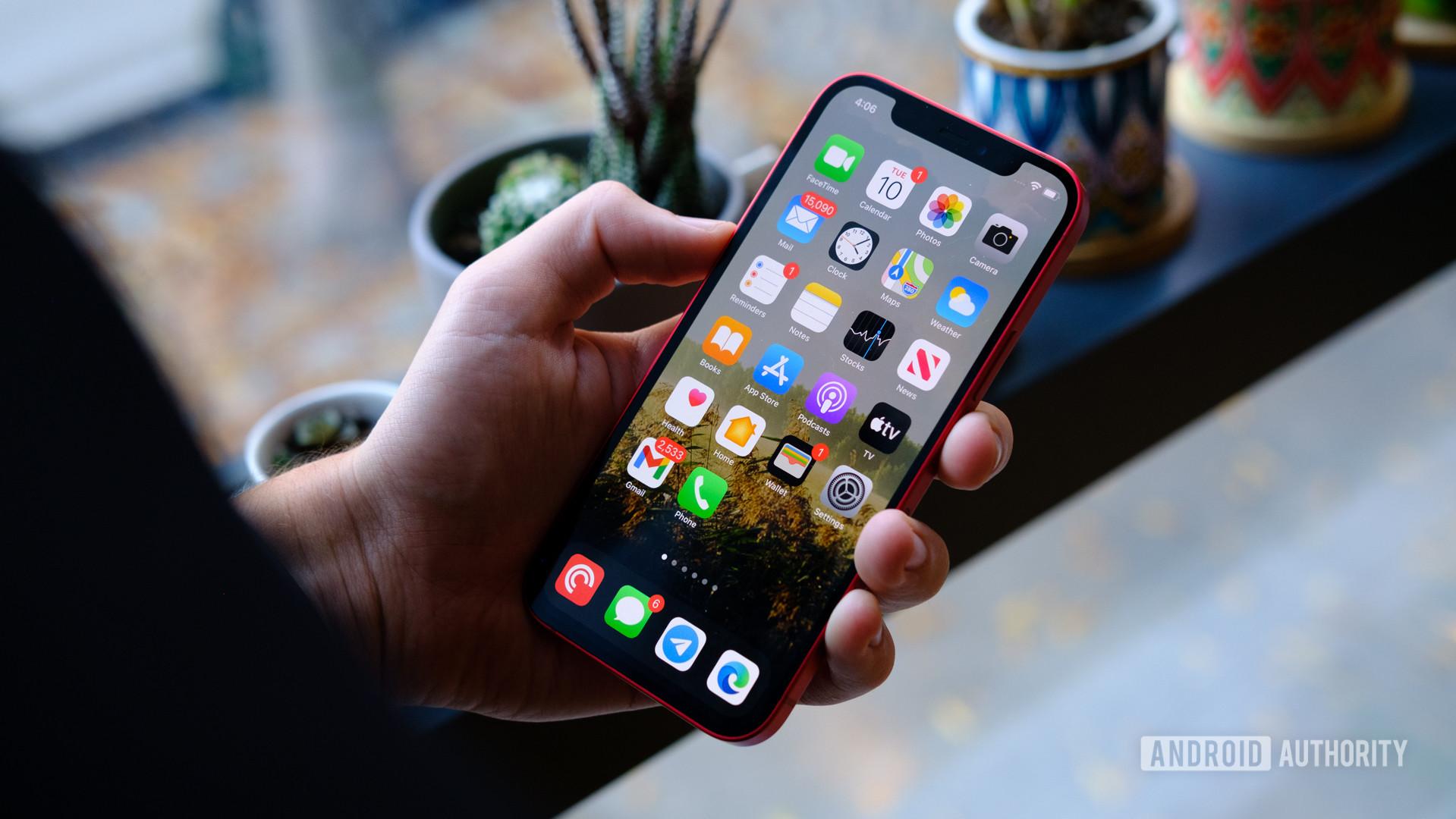 iPhone 12 in hand screen 1