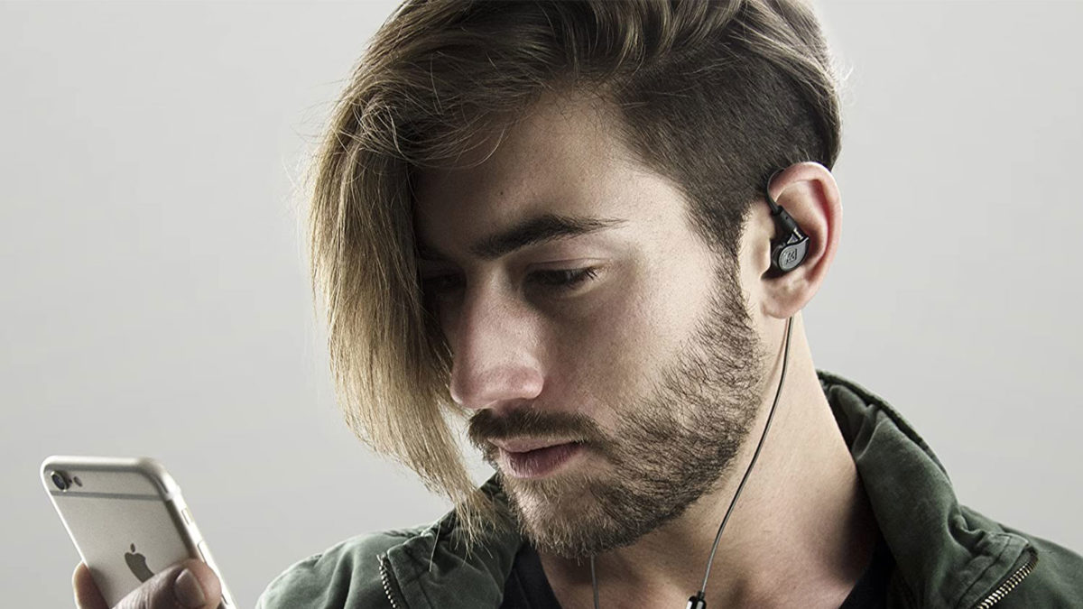 A man wears the MEE audio M6 PRO wired IEMs.