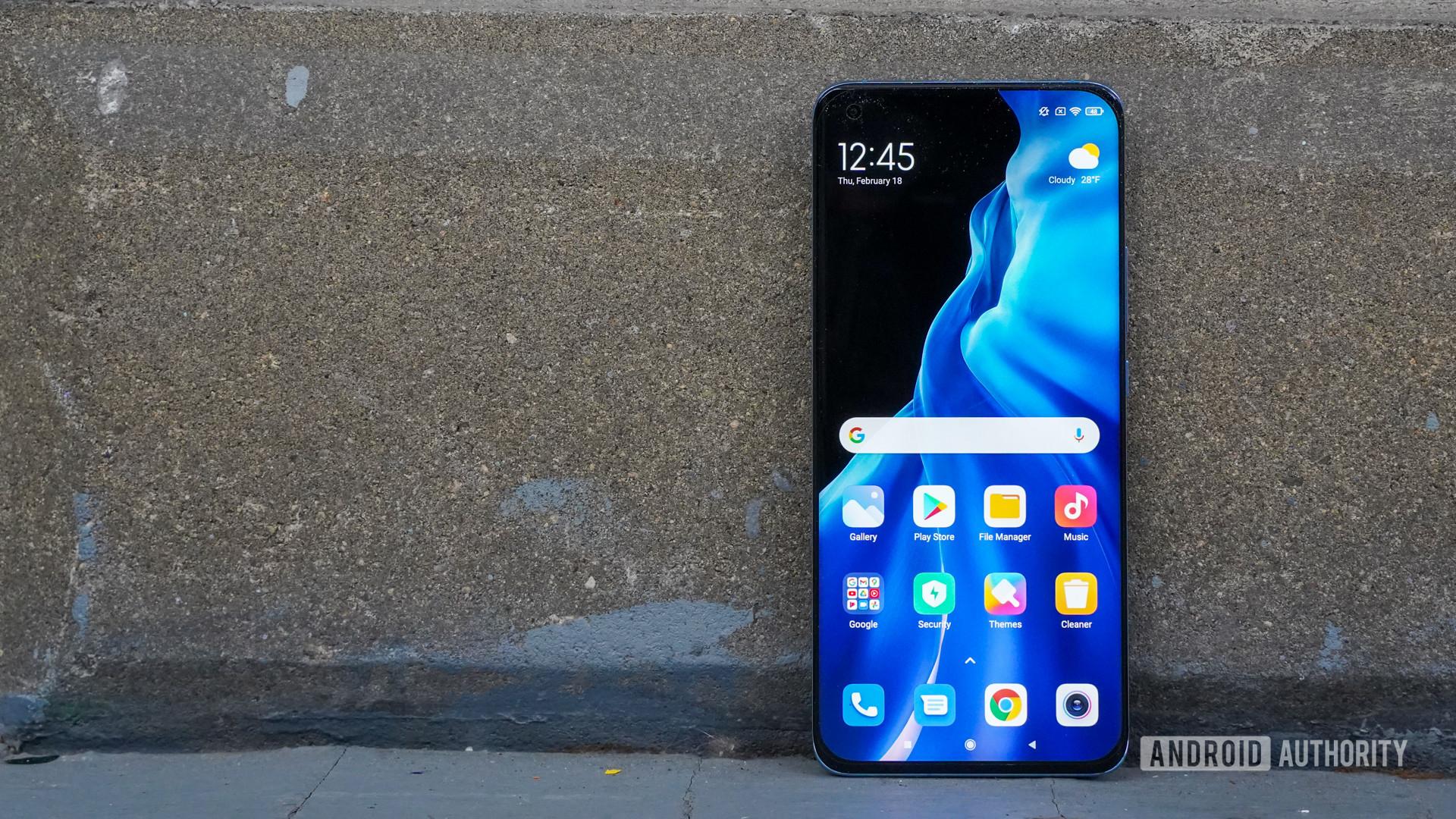 Xiaomi Mi 11 face against brick