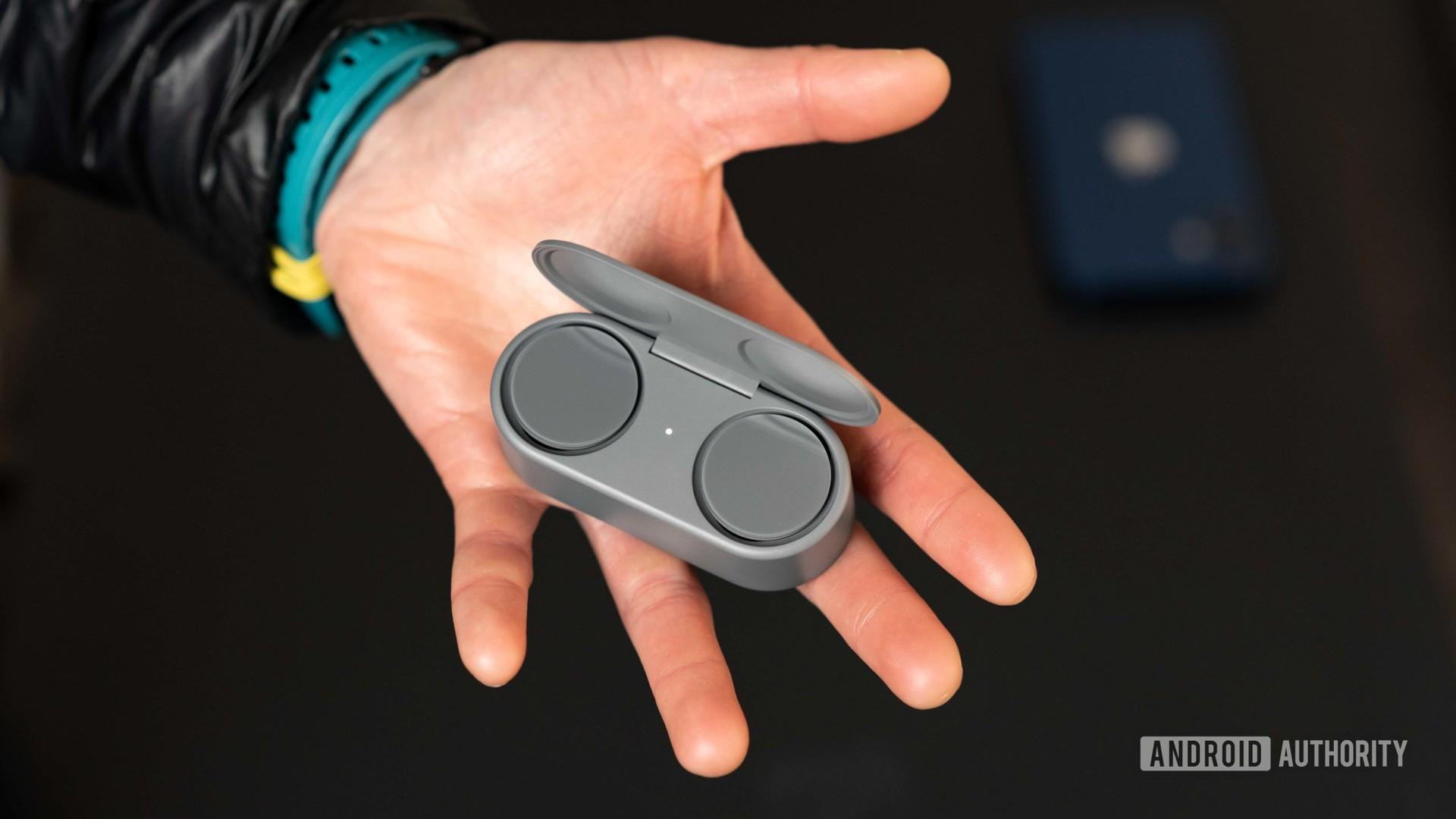 Microsoft Surface Earbuds true wireless earbuds open case hand