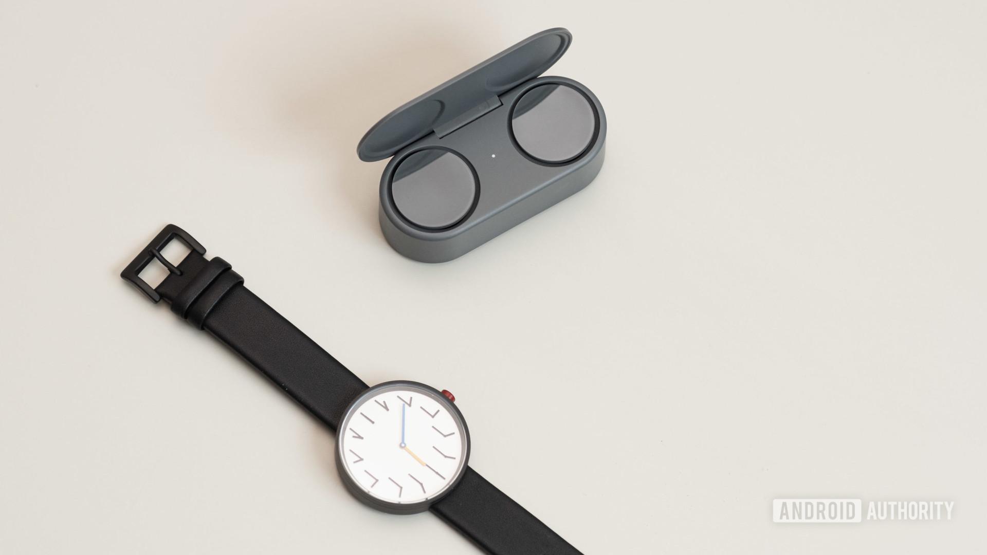 Microsoft Surface Earbuds true wireless earbuds open case watch