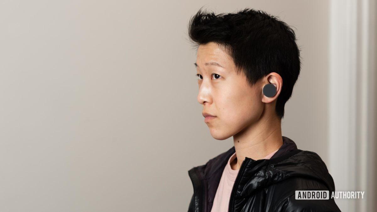 Microsoft Surface Earbuds true wireless earbuds woman wears 1